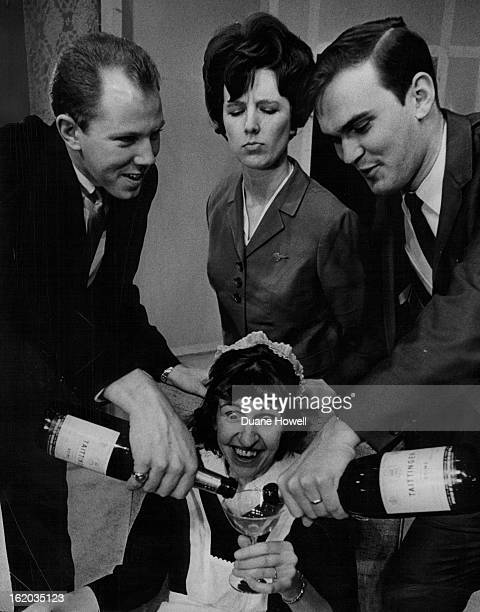 FEB 15 1966 FEB 24 1966 Happy Moment at Bonfils Virginia Seymore is the maid being plied with champagne by Ray Kingston left and Richard Jamison...