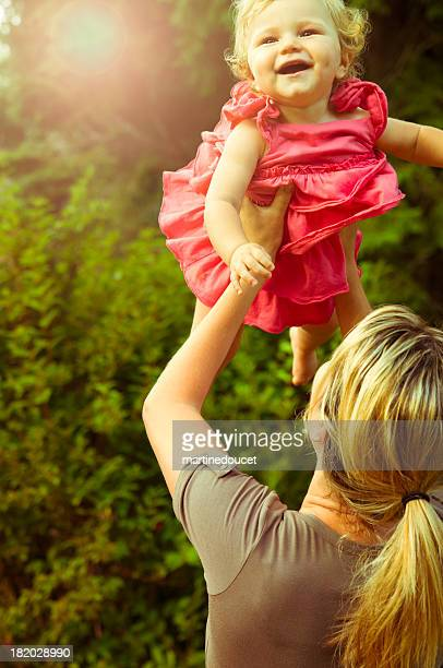 """happy moment between mother and child in the summer garden. - """"martine doucet"""" or martinedoucet stock pictures, royalty-free photos & images"""