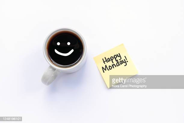 happy monday text on paper note and cup of black coffee - monday stock pictures, royalty-free photos & images