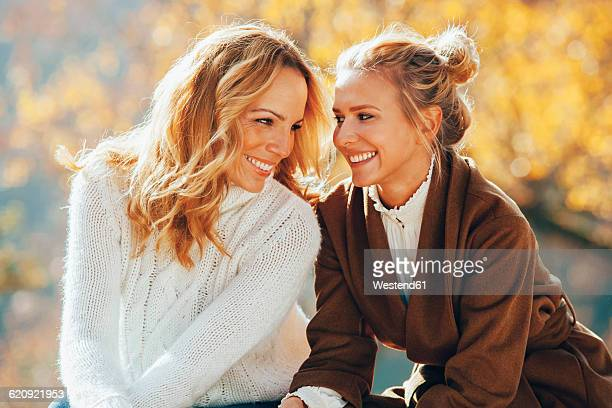 Happy mother and adult daughter in autumn