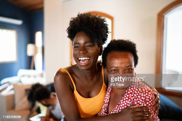 happy mother and daughter embracing - real life stock pictures, royalty-free photos & images