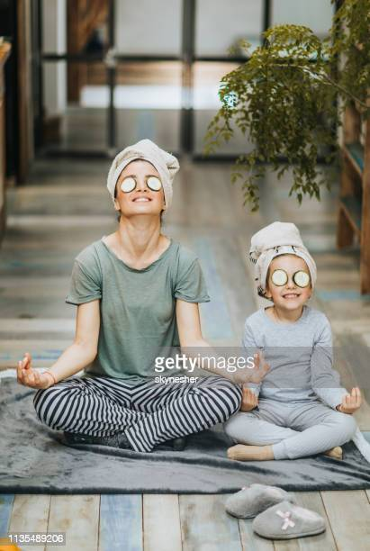 happy mother and daughter exercising yoga in the morning at home. - body care stock pictures, royalty-free photos & images
