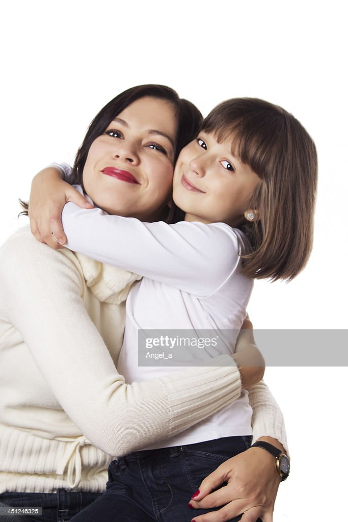 Happy mother and daughter hugging : Stock Photo