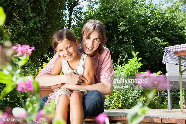 Happy mother and daughter in garden