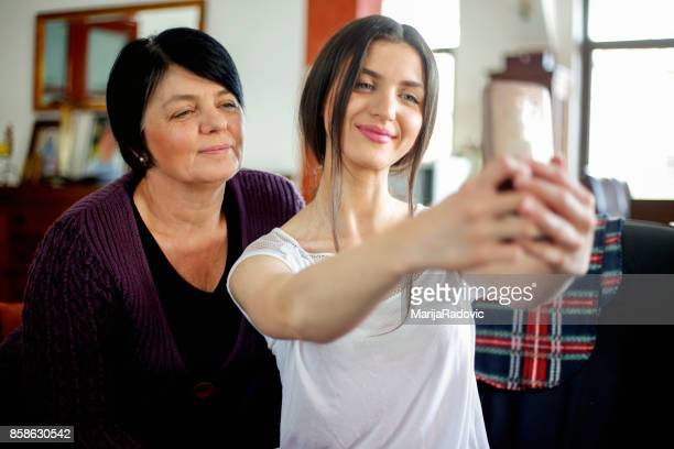 Happy mother and daughter make selfie
