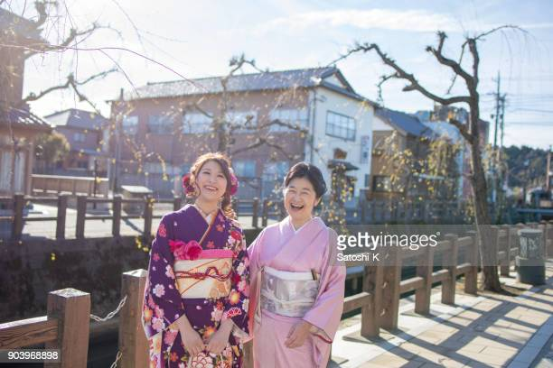 happy mother and daughter on coming of age day - seijin no hi stock pictures, royalty-free photos & images