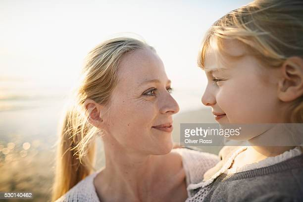 Happy mother and daughter on the beach