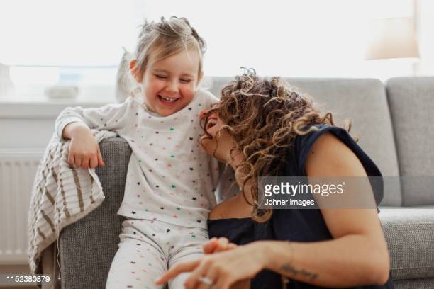 happy mother and daughter - nightwear stock pictures, royalty-free photos & images