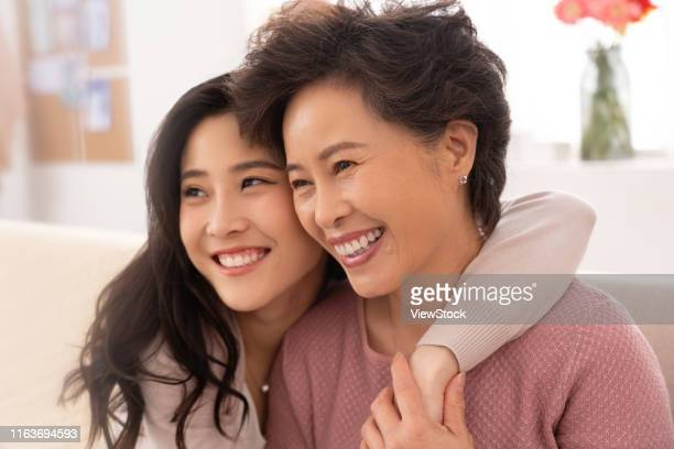 happy mother and daughter - chinese mothers day stock pictures, royalty-free photos & images