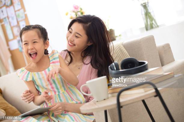 happy mother and daughter playing at home - chinese mothers day stock pictures, royalty-free photos & images
