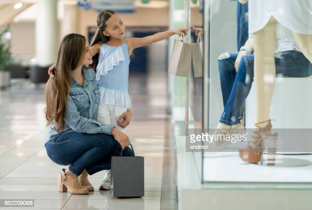 Happy mother and daughter shopping at the mall