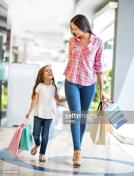 Happy mother and daughter shopping