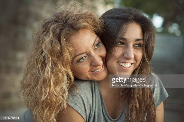 Happy mother and daughter smiling
