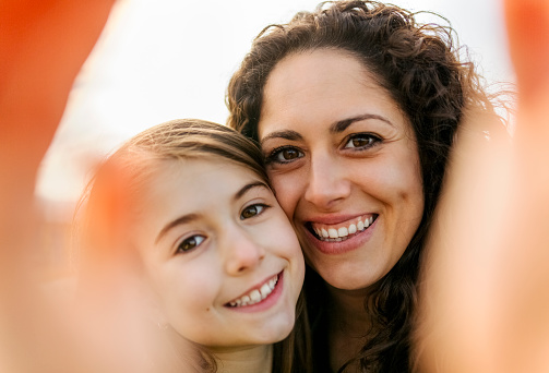 Happy mother and daughter taking a selfie - gettyimageskorea