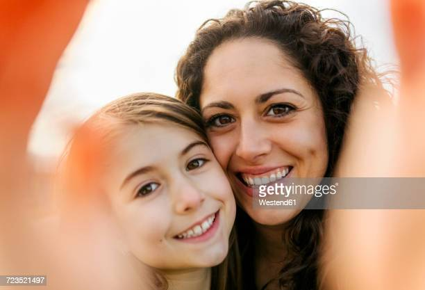 happy mother and daughter taking a selfie - 8 9 years photos stock photos and pictures