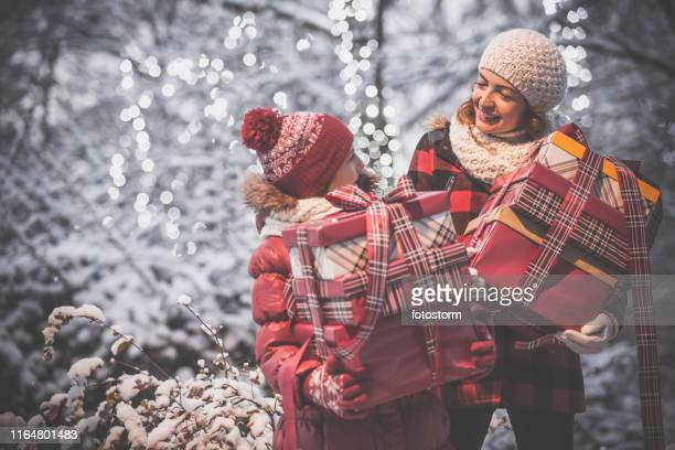 happy mother and daughter with enjoying winter holidays in the city - happy holidays stock photos and pictures