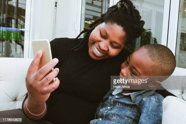 Happy mother and son getting some face time on cell phone