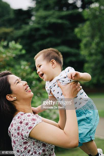 Happy mother and son having fun together outdoors