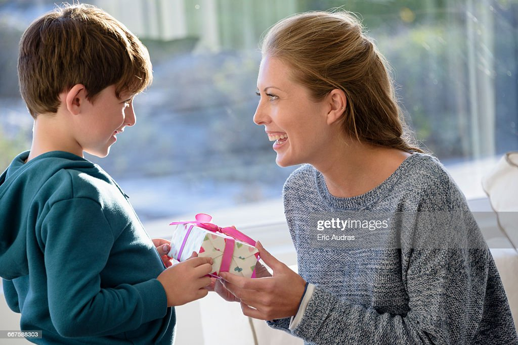 Happy Mother And Son With Birthday Gift Stock Photo
