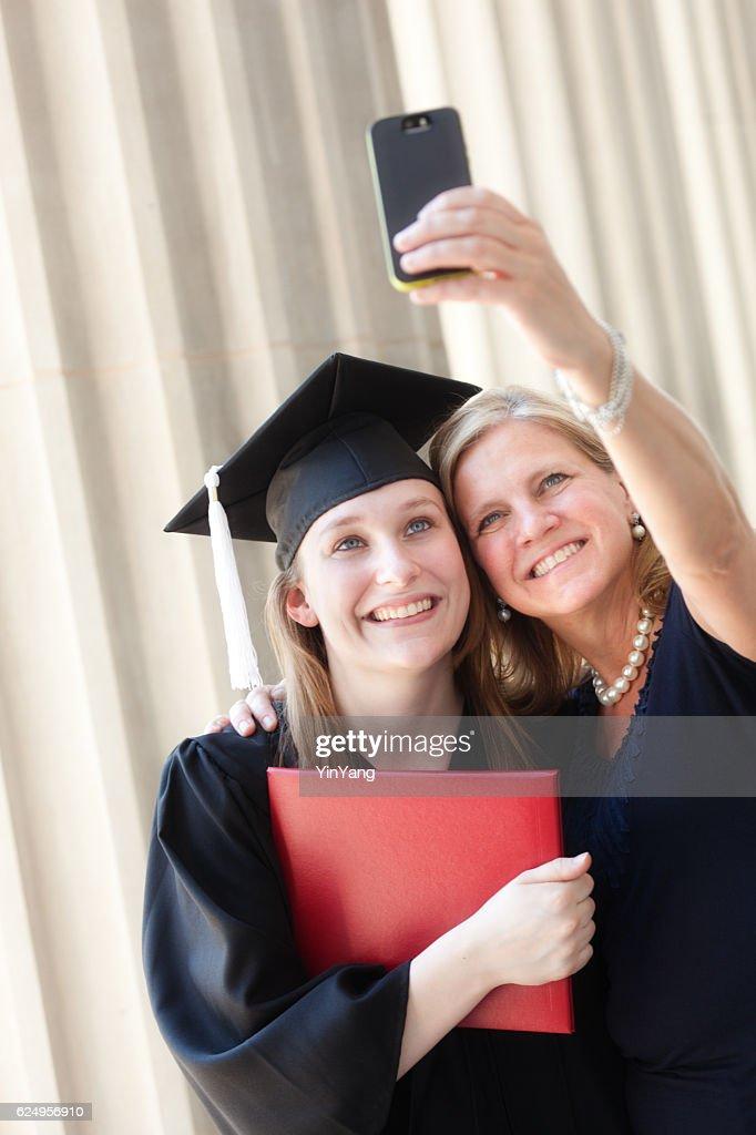 36237f9e685 Happy Mother Congratulating Hugging Daughter in University Graduation  Ceremony   Stock Photo