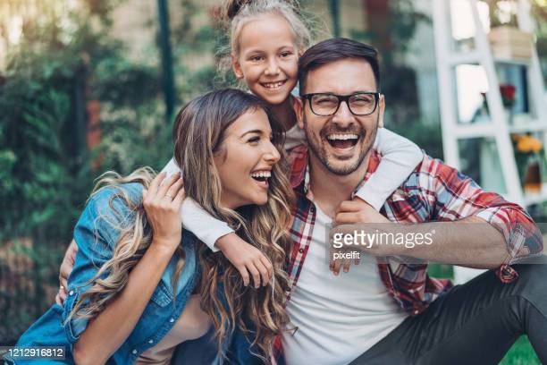 happy mother, father and daughter - bulgaria stock pictures, royalty-free photos & images