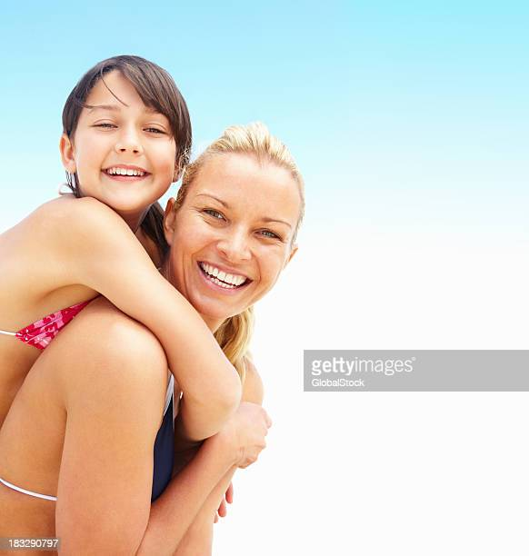 World's Best Daughter Giving Mom A Piggyback Ride Stock