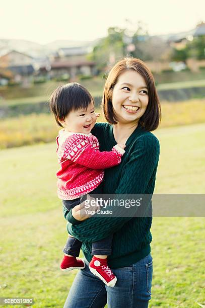 Happy mother having a good time with baby girl