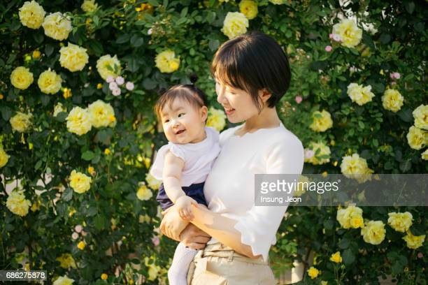 Happy Mother playing with daughter in park