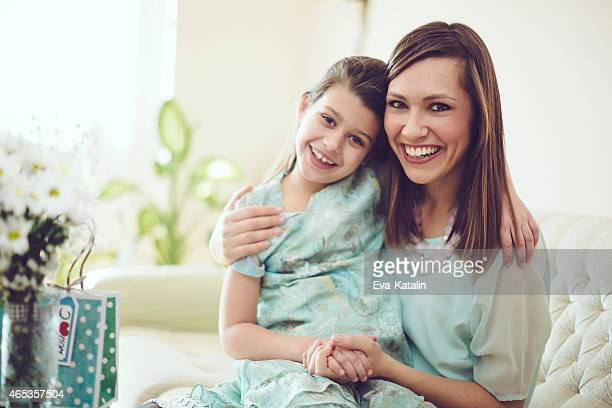 Happy mother posing with her daughter