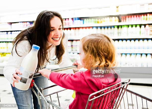 Happy mother shopping with daughter