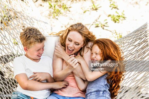 happy mother with children in hammock - family with two children stock pictures, royalty-free photos & images