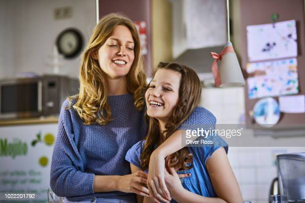 happy mother with daughter at home - pre adolescent child stock pictures, royalty-free photos & images