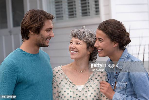 Happy mother with her adult children outside