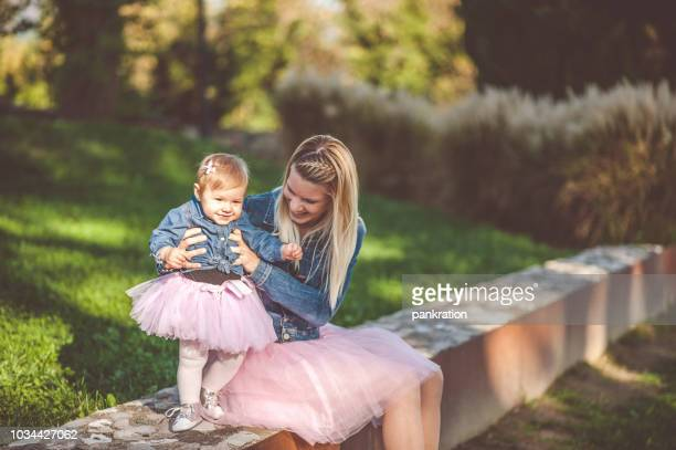 Happy Mother With Her Little Daughter Both Dressed In Tutu