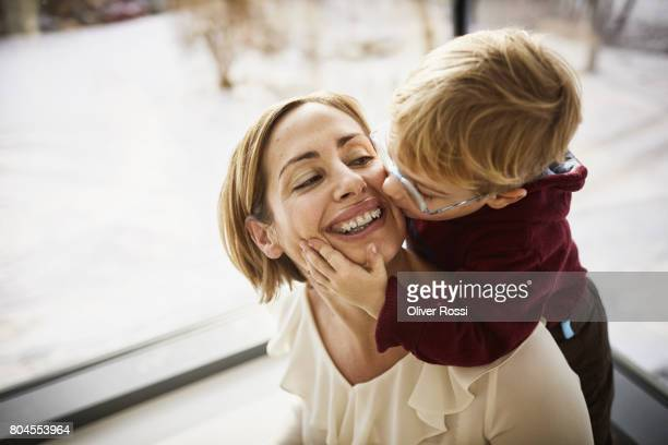 happy mother with son at home - frau bluse durchsichtig stock-fotos und bilder