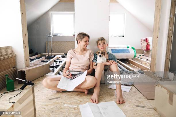 happy mother with son in a home to be renovated - reform stock pictures, royalty-free photos & images