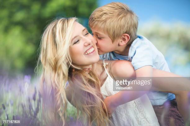 Happy mother with son in lavender field