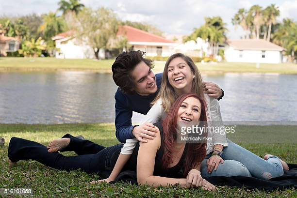 happy mother with young adult children - mexican mothers day stock photos and pictures