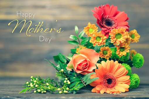 Happy Mothers Day card with flowers on wooden background 1145523085