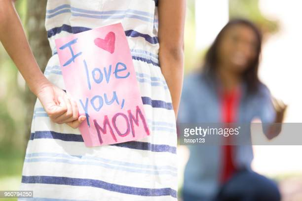 happy mother's day. girl gives card to mother. - mothers day card stock pictures, royalty-free photos & images