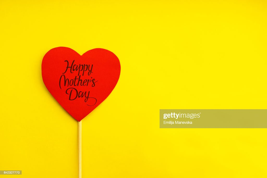 Happy Mother's Day. Red paper heart on yellow background : Stock Photo