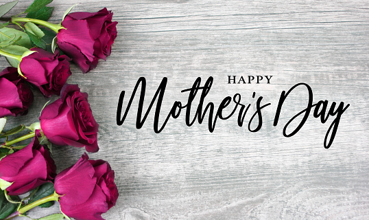Happy Mother's Day Typography with Bright Pink Roses Over Wood 912699528