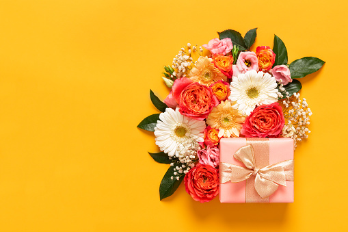 Happy Mother's Day, Women's Day, Valentine's Day or Birthday Pastel Candy Colors Background. Floral flat lay greeting card with beautifuly wrapped present and copy space. 1129642064