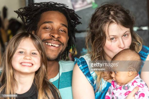 happy multi ethnic family (real people) - alternative lifestyle stock pictures, royalty-free photos & images