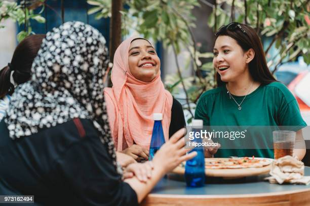 happy multi ethnic friends together - malay hijab stock photos and pictures