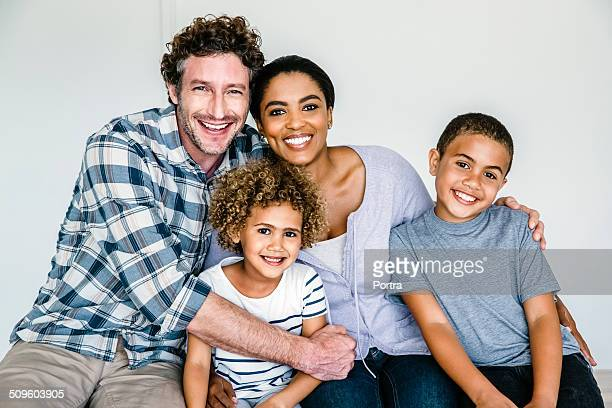 happy multi-ethnic family at home - mixed race person stock pictures, royalty-free photos & images