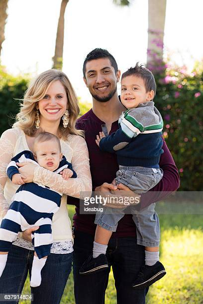 Happy Multi-Ethnic Family of Four Outside, Hispanic, Caucasian