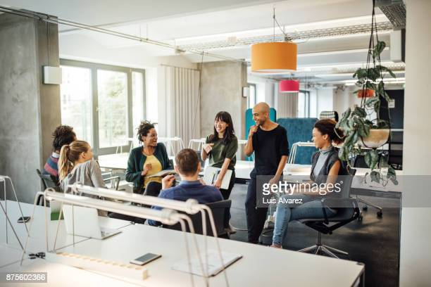 happy multi-ethnic people discussing at office - new business stock pictures, royalty-free photos & images