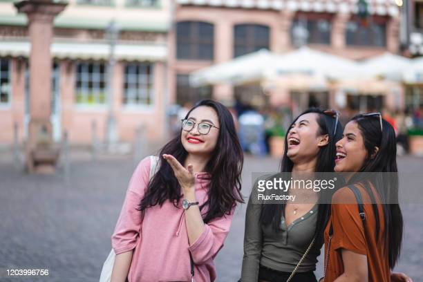 happy multi-ethnic women joking around while on an adventure - hesse germany stock pictures, royalty-free photos & images