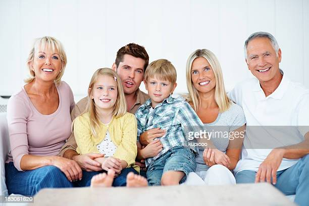 Happy multi-generational family relaxing together at home